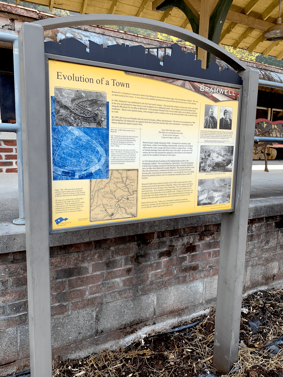 Information board entitled evolution of a town, outside train depot in Bramwell, WV